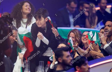 Stock Picture of Kristian Kostov from Bulgaria, center, reacts during the voting stage of the the Final for the Eurovision Song Contest, in Kiev, Ukraine