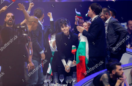 Stock Image of Kristian Kostov from Bulgaria, center, reacts after placing second in the the Final of the Eurovision Song Contest, in Kiev, Ukraine