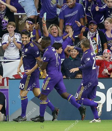 Kaka, Carlos Rivas, Antonio Nocerino Orlando City's Kaka (10) celebrates his goal against Sporting Kansas City with teammates Carlos Rivas (11) and Antonio Nocerino, right, during the first half of an MLS soccer game, in Orlando, Fla