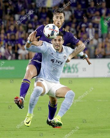 Conor Donovan, Kevin Ellis Sporting Kansas City's Kevin Ellis, front, gets position on Orlando City's Conor Donovan during the second half of an MLS soccer match, in Orlando, Fla. The game ended in a 2-2 draw