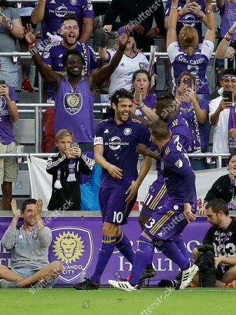 Kaka, Carlos Rivas, Antonio Nocerino Orlando City's Kaka, left, celebrates his goal against Sporting Kansas City with teammates Carlos Rivas (11) and Antonio Nocerino, right, during the first half of an MLS soccer game, in Orlando, Fla