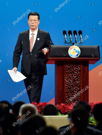 Chinese Vice Premier Zhang Gaoli leaves from the stage after delivering a speech on Plenary Session of High-Level Dialogue, at the Belt and Road Forum in Beijing