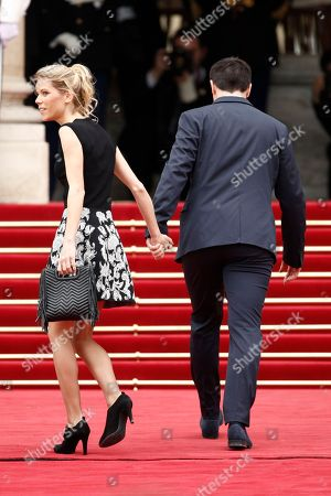 Emmanuel Macron's stepdaughter Tiphaine Auziere and her husband Antoine Choteau arrive before Macron's inauguration ceremony as French President, at the Elysee Palace in Paris