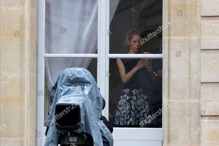 Macron's step-daughter Tiphaine Auziere appears behind a window at the Elysee Palace in Paris. France has inaugurated new president, Emmanuel Macron, a 39-year-old independent centrist who was elected on May 7