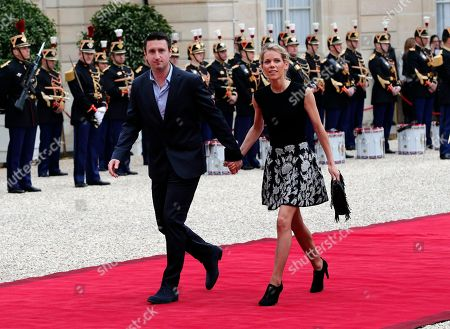 French President-elect Emmanuel Macron's step-daughter Tiphaine Auziere and her husband Antoine arrive before the handover ceremony, in Paris, France
