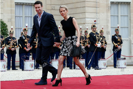 Tiphaine Auziere, daughter of Brigitte Trogneux, and her husband Antoine arrive at the Elysee Palace in Paris