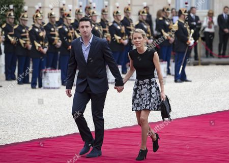 Emmanuel Macron's stepdaughter Tiphaine Auziere (L) and her husband Antoine Choteau (R) arrive at the Elysee Palace prior to the handover ceremony for New French President Emmanuel Macron (unseen), in Paris, France, 14 May 2017. Emmanuel Macron was inaugurated as the 25th President of the French Republic after taking over power from Francois Hollande in a ceremony at the Elysee Palace.