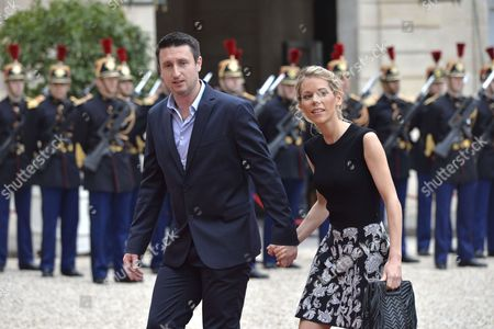 Macron's step-daughter Tiphaine Auziere (L) and her husband Antoine Choteau at the Elysee Palace