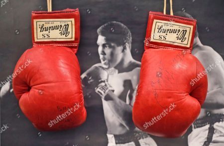 On, boxing gloves worn by boxing legend Muhammad Ali during his World Heavyweight Championship fight against Joe Bugner in Kuala Lumpur in 1975, on display prior to an auction of sporting memorabilia by Graham Budd Auctions, in London. The gloves are estimated to fetch approximately 40,000-60,000 pounds, $ 51,000-77,000 in an auction held on the first day of a two-day sale on Monday