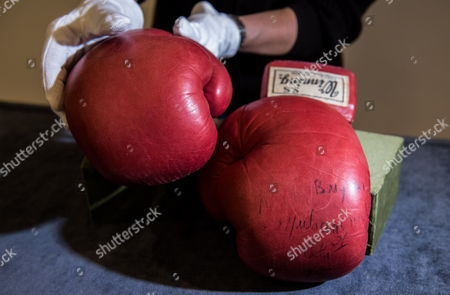 Stock Picture of The iconic boxing gloves worn by Muhammad Ali in the World Heavyweight Championship bout versus Joe Bugner in Kuala Lumpur on 30th June 1975 are expected to fetch £40,000-60,000 when they are included in an auction of Sporting Memorabilia by Graham Budd Auctions on May 15th 2017