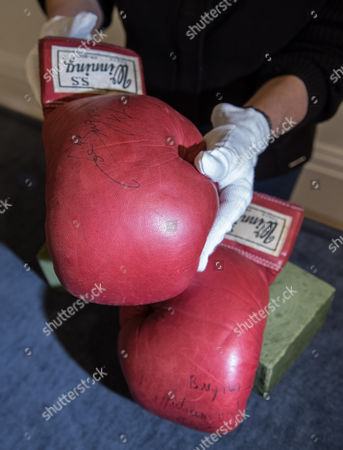 Editorial image of Muhammad Ali's gloves from World Heavyweight Championship fight photocall, Sotheby's, London, UK - 14 May 2017