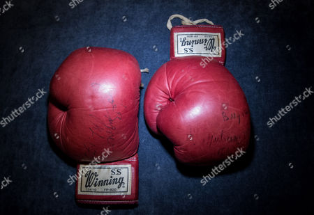 Editorial photo of Muhammad Ali's gloves from World Heavyweight Championship fight photocall, Sotheby's, London, UK - 14 May 2017