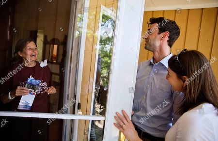 Jon Ossoff, Alisha Kramer, Marilyn Matlock Marilyn Matlock, left, answers her door to Jon Ossoff, center, a 30-year-old Democrat running for Congress in Georgia's traditionally conservative 6th Congressional District, as he campaigns in the neighborhood with fiancee Alisha Kramer in Sandy Springs, Ga., . Ossoff's fortunes in a June 20 matchup with Republican Karen Handel will be an early test of how the Republicans' vote to gut the Affordable Care Act and President Donald Trump's decision to fire the FBI director are playing with voters. Both parties see the Georgia race as an indicator for the 2018 midterm elections