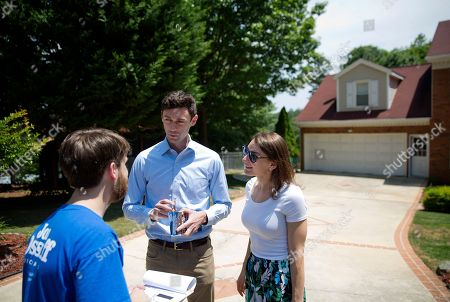 Jon Ossoff, Alisha Kramer, Eliot Beckham Jon Ossoff, center, a 30-year-old Democrat running for Congress in Georgia's traditionally conservative 6th Congressional District, and fiancee Alisha Kramer, right, talk with organizer Eliot Beckham while campaigning in Sandy Springs, Ga., . Ossoff's fortunes in a June 20 matchup with Republican Karen Handel will be an early test of how the Republicans' vote to gut the Affordable Care Act and President Donald Trump's decision to fire the FBI director are playing with voters. Both parties see the Georgia race as an indicator for the 2018 midterm elections
