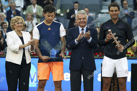 Spanish tennis player Rafael Nadal (R) celebrates his victory next to former tennis player Manolo Santana (2R) and Mayoress of Madrid, Manuela Carmena (L), in the Mutua Madrid Open men's final match against Austrian Dominic Thiem (2L) at the Magic Box in Madrid, Spain, 14 May 2017.