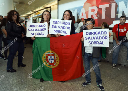 Salvador Sobral fans with banners 'Thank you Salvador Sobral'  wait for him and his sister Luisa Sobral at Lisbon Airport after he won the Grand Final of the 62nd annual Eurovision Song Contest (ESC) in Ukraine, in Lisbon, Portugal, 14 May 2017.