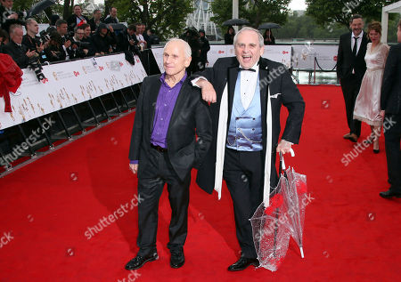 Sylvester McCoy, right, and dancer Wayne Sleep pose for photographers upon arrival to the British Academy Television Awards at the Royal Festival Hall in London