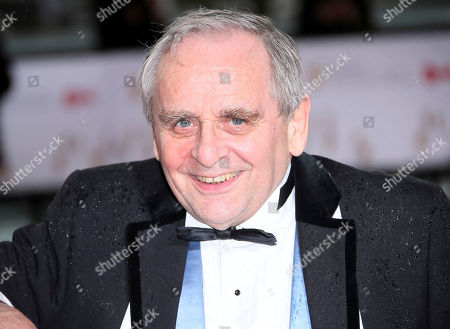 Sylvester McCoy poses for photographers upon arrival to the British Academy Television Awards at the Royal Festival Hall in London
