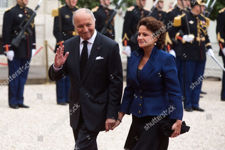 Stock Photo of Laurent Fabius and wife Francoise Castro at the presidential Elysee Palace for Emmanuel Macron 's presidential inauguration as the 8th president of the 5th Republic