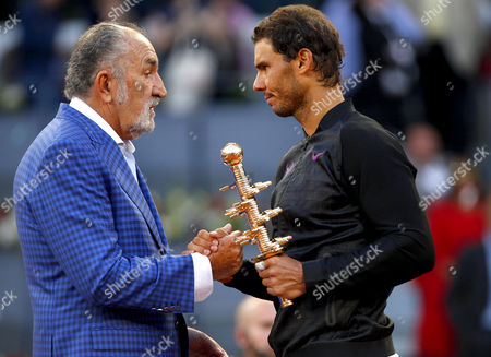 Rafael Nadal of Spain celebrates with the Champion's Trophy and Ion Tiriac at the Mutua Madrid Open, Madrid, Spain on Sunday, May 14th, 2017