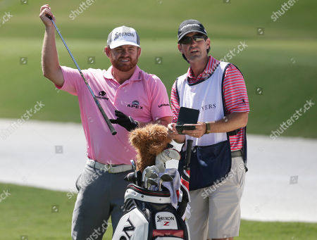 J.B. Holmes, Brandon Parsons J. B. Holmes, left, and his caddie Brandon Parsons, look at the fifth fairway during the final round of The Players Championship golf tournament, in Ponte Vedra Beach, Fla