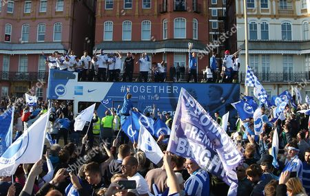 Brighton & Hove Albion central midfielder Steve Sidwell (14) lifts the trophy on the open top bus during the Brighton & Hove Albion Football Club Promotion Parade at Brighton Seafront, Brighton