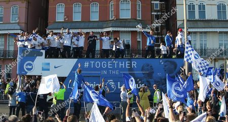 Brighton players on open top bus and Brighton & Hove Albion central midfielder Steve Sidwell (14) with trophy during the Brighton & Hove Albion Football Club Promotion Parade at Brighton Seafront, Brighton