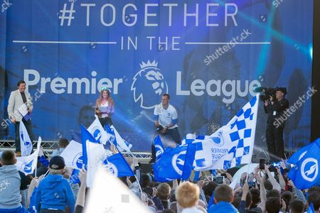 Brighton & Hove Albion central midfielder Steve Sidwell (14) opens the champagne on the stage during the Brighton & Hove Albion Football Club Promotion Parade at Brighton Seafront, Brighton