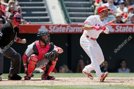 Danny Espinosa, James McCann, Marty Foster Los Angeles Angels' Danny Espinosa follows through after he hits a solo home run with Detroit Tigers catcher James McCann, center, and home plate umpire Marty Foster, left, watching during the fourth inning of a baseball game in Anaheim, Calif