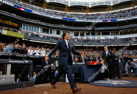 Retired New York Yankees outfielder Hideki Matsui during a pregame ceremony retiring his number 2 in Monument Park at Yankee Stadium in New York