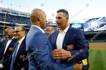 Derek Jeter, Andy Pettitte Retired New York Yankees shortstop Derek Jeter, second from right, embraces retired Yankees pitcher Andy Petttite, right, during an on-field, pregame ceremony retiring Jeter's number 2 in Monument Park at Yankee Stadium in New York, . Mariano Rivera, far left, and Major League Baseball's Chief Baseball Officer Joe Torre, second from left, also participated in the ceremony