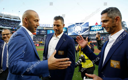 Joe Torre, Derek Jeter, Andy Pettitte, Jorge Posada Retired New York Yankees shortstop Derek Jeter, second from left, prepares to share hands with retired Yankees catcher Jorge Posada, far right, with another retired Yankee pitcher, Andy Pettitte, between them as Joe Torre, Major League Baseball's Chief Baseball Officer looking, far left, during an on-field, pregame ceremony retiring Jeter's number 2 at Yankee Stadium in New York, . Torre managed the Yankees during much of Jeter's time as a player and led the team to four World Series titles