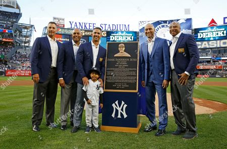 Andy Pettitte, Mariano Rivera, Jorge Posada, Jaden Jeter, Derek Jeter, Bernie Williams From left, retired New York Yankees pitcher Andy Pettitte, retired Yankees pitcher Mariano Rivera, retired Yankees catcher Jorge Posada, retired Yankees shortstop Derek Jeter, and retired Yankees outfielder Bernie Williams pose for a photograph with Jeter's nephew Jaden Jeter during an on-field, pregame ceremony retiring Jeter's number 2 at Yankee Stadium in New York