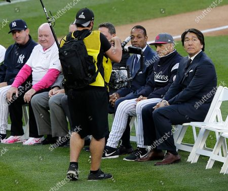 Former New York Yankee Hideki Matsui, right, participates in a ceremony retiring Derek Jeter's number at Yankee Stadium, in New York