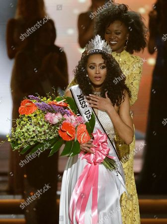 Miss District of Columbia USA Kara McCullough reacts as she is crowned the new Miss USA by former Miss USA Deshauna Barber during the Miss USA contest, in Las Vegas