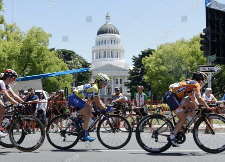 Katie Hall, center, of the UnitedHealthCare cycling team passes the state Capitol during the final stage of the Women's Amgen Tour of California cycling race, in Sacramento, Calif. Giorgia Bronzini, of Wiggle High5 won the final stage of the race and Anna van der Breggen of Boels Dolman Cycling Team won the overall race. Hall finished third overall
