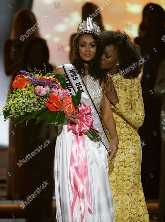 Miss District of Columbia USA Kara McCullough, left, reacts as she is crowned the new Miss USA by former Miss USA Deshauna Barber during the Miss USA contest, in Las Vegas