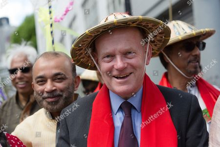 John Biggs, Mayor of Tower Hamlets joins performers to dance in the street during the Boishakhi Mela street parade festival along and around Brick Lane in east London to celebrate the Bengali New Year.