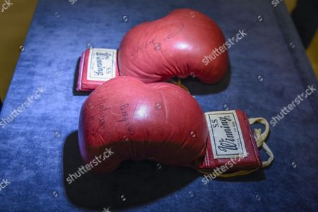 A pair of boxing gloves worn and signed by Muhammad Ali in the World Heavyweight Championship bout with Joe Bugner in Kuala Lumpur on 30 June 1975 are presented at a press preview. The red Winning S.S. FP-800, Tokyo, 10oz. boxing gloves with original lacing are offered by Graham Budd Auctions at Sotheby's on a sale of Sporting Memorabilia on 15 May 2017.