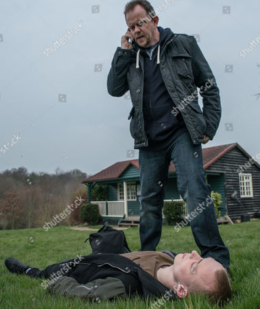 Dan Spencer, as played by Liam Fox, braces himself as he arrives at the cricket pavilion and sees Josh, as played by Conner Chapman, lying motionless with blood seeping out of his head. He dials 999 but then ends the call - but someone's watching in the shadows? (Ep 7828 - Thur 18 May 2017)