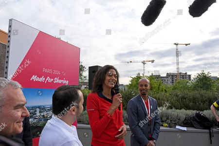 French French basketball player and Olympic Games 2012 silver medalist Emmeline Ndongue (C) and members of the French organising committee speak to the press at the 'Cine du Cinema' site of the planned Olympic village, during the press tour of the International Olympic Committee (IOC) Evaluation Commission, in Saint Denis, North of Paris, 15 May 2017. The cities of Paris and Los Angeles are currently bidding to host the Olympic Games 2024.