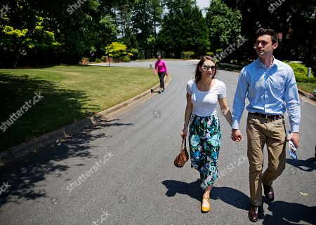 Jon Ossoff, Alisha Kramer Jon Ossoff, right a 30-year-old Democrat running for Congress in Georgia's traditionally conservative 6th Congressional District, and fiancee Alisha Kramer, left, walk through a neighborhood while campaigning in Sandy Springs, Ga., . Ossoff's fortunes in a June 20 matchup with Republican Karen Handel will be an early test of how the Republicans' vote to gut the Affordable Care Act and President Donald Trump's decision to fire the FBI director are playing with voters. Both parties see the Georgia race as an indicator for the 2018 midterm elections