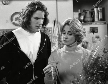 Kathy sends red roses to Bernard and Angharad is furious - With Luke McAllister, as played by Noah Huntley, and Angharad McAllister, as played by Amanda Wenban (Ep 1931 - 20th December 1994).