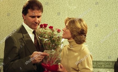 Angharad brings Kathy's flowers to Bernard's surgery and demands to know what is going on - With Bernard McAllister, as played by Brendan Price, and Angharad McAllister, as played by Amanda Wenban (Ep 1931 - 20th December 1994).