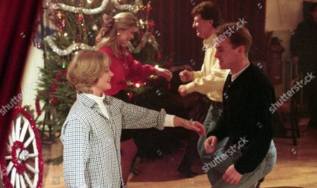 It's the village barn dance - With Biff Fowler, as played by Stuart Wade ; Angharad McAllister, as played by Amanda Wenban ; Frank Tate, as played by Norman Bowler, and Kim Tate, as played by Claire King. (Ep 1934 - 29th December 1994).