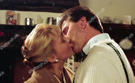Bernard comforts Kathy after her break up with Chris, Kathy kisses Bernard - With Bernard, as played by Brendan Price, and Kathy Tate, as played by Malandra Burrows. (Ep 1929 - 13th December 1994).