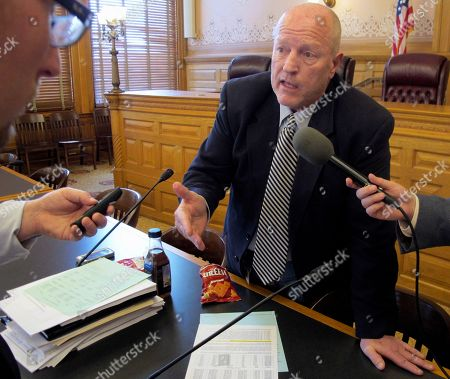 Kansas state Rep. Larry Campbell, R-Olathe, chairman of a special House committee on education funding, answers questions from reporters after it approved a plan for increasing aid to public schools, at the Statehouse in Topeka, Kan. The committee has approved a plan to phase in a $280 million increase over two years
