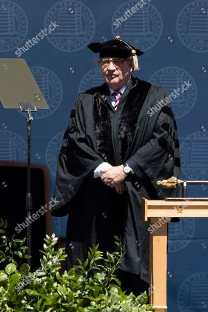Poet Paul Muldoon stands to receive an an honorary degree during the University of Pennsylvania commencement ceremony, in Philadelphia