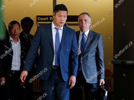 "Raymond Lam, center, leaves the Monroe County Courthouse in Stroudsburg, Pa., . Lam pleaded guilty to voluntary manslaughter in the death of Chun ""Michael"" Deng, a fraternity pledge at Baruch College in New York"