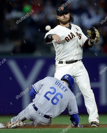 Chase Utley, Brandon Crawford San Francisco Giants' Brandon Crawford throws to first base to complete a double play over Los Angeles Dodgers' Chase Utley (26) in the fourth inning of a baseball game, in San Francisco. Dodgers' Chris Taylor was out at first base